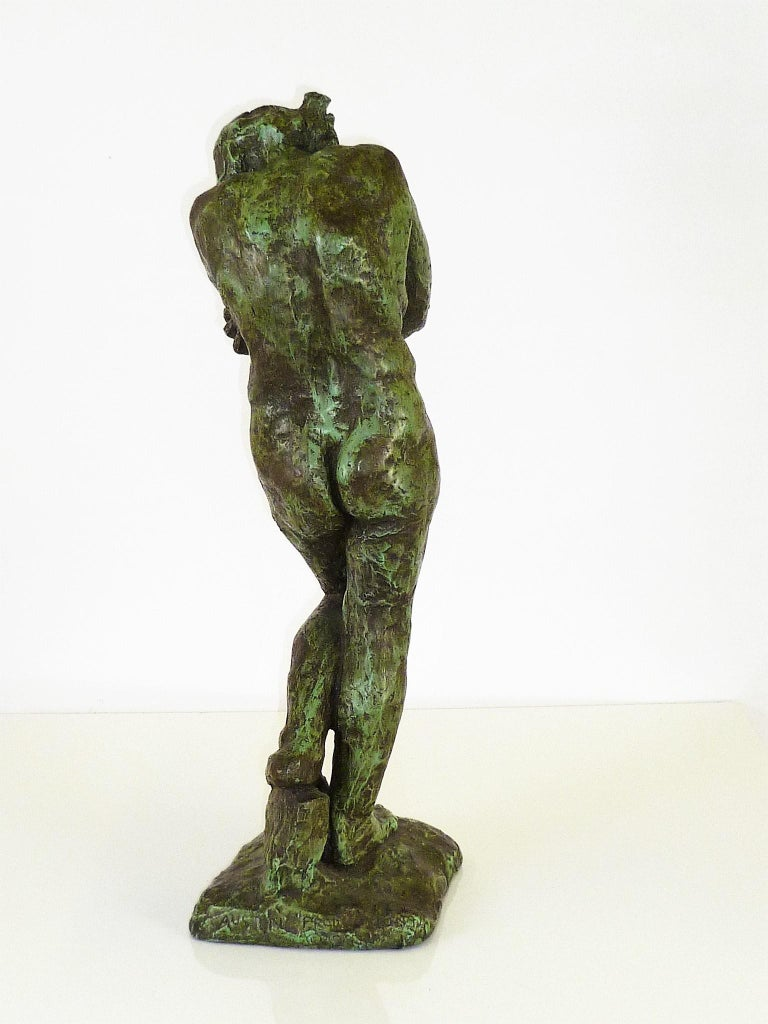 Classical female nude, reproduced in 1962 in verdigris plaster to resemble aged bronze of Eve in Rodin's The Gates of Hell creation of 1881. Rodin borrowed the stand of Eve from Micheangelo's The Expulsion from Paradise painted in the ceiling of the