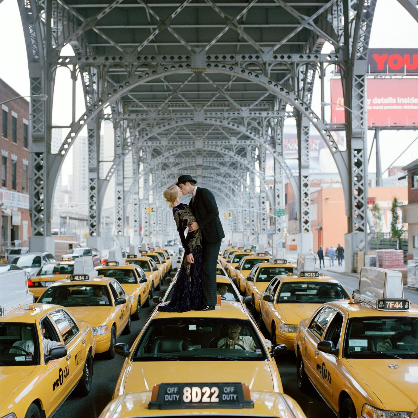 Edythe and Andrew Kissing on Taxis- Framed photograph by Rodney Smith