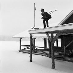 Reed Skiing off Roof- black and white framed photograph by rodney smith