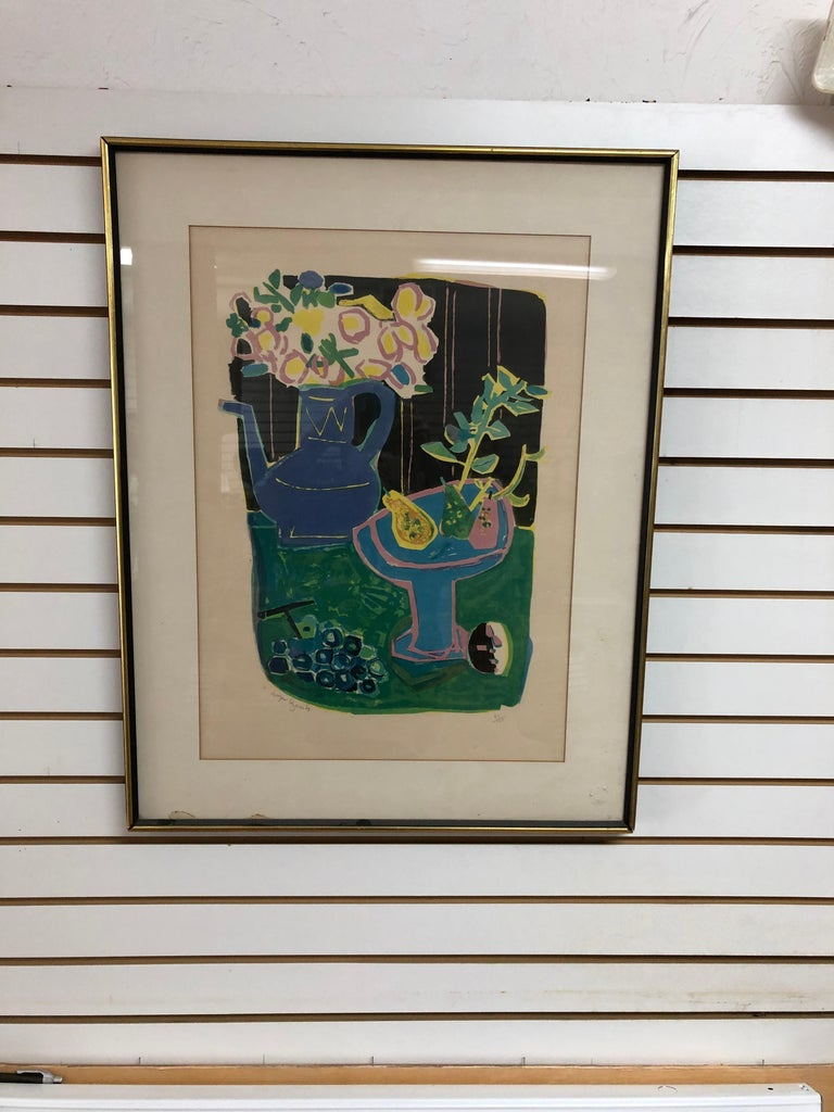 Roger Bezombes: 1913-1994. Well listed French artist with auction prices for lithographs over $2000. This fantastically colorful still life is pencil signed and numbered 83/125. He completed this piece in 1958. Sorry for the glare in pictures very