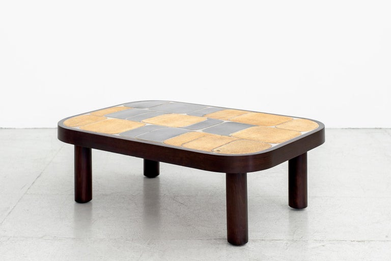 Wonderful ceramic tile top coffee table designed by Roger Capron. (signed)  Features his unique