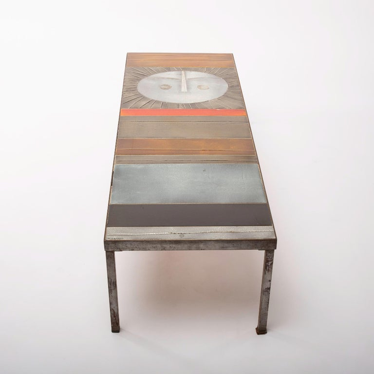 Exceptional table composed of a steel structure covered with abstract ceramics, one of which is a radiant sun. This is the largest version of the model. An iconic piece of one of the greatest French ceramists of the post-war period, circa