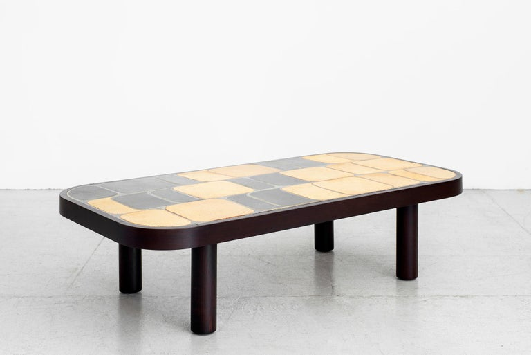 Large sized ceramic tile top coffee table designed by Roger Capron (signed). Features his unique