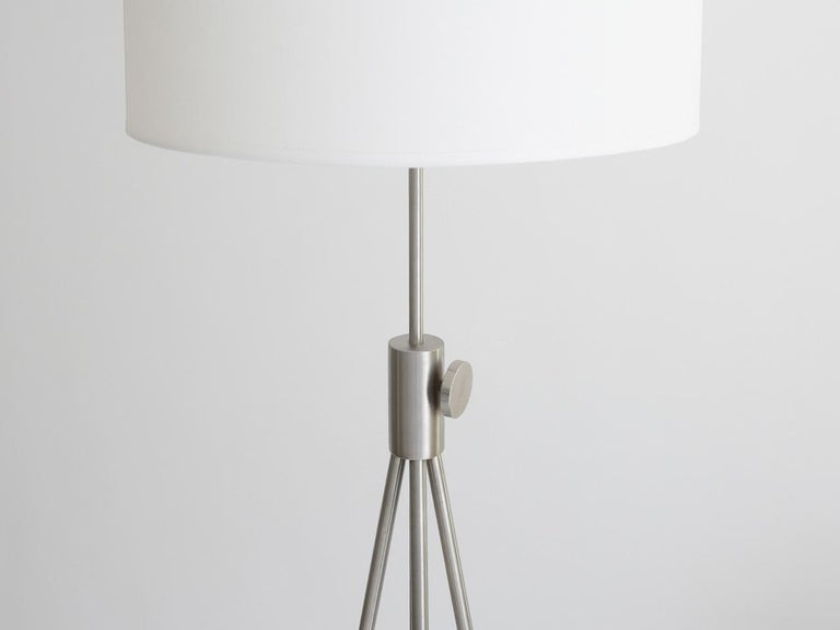 Ideal for placing at the end of a sofa, this floor lamp is adjustable in height, provides the soft light of a traditional lampshade, and creates what has become a Classic design from the 1950s.