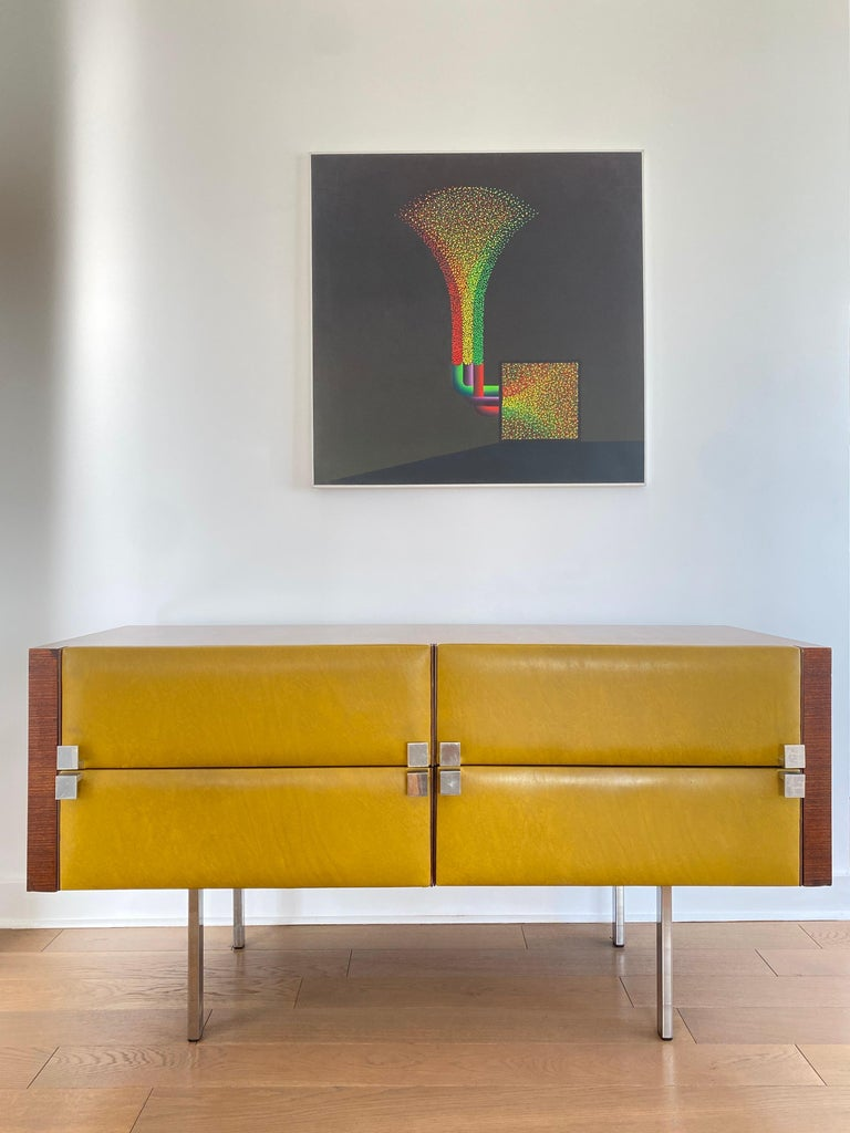 Chest of drawers by Roger Landault with original faux leather Legs and Handels in chrome Good vintage condition, Circa 1960.