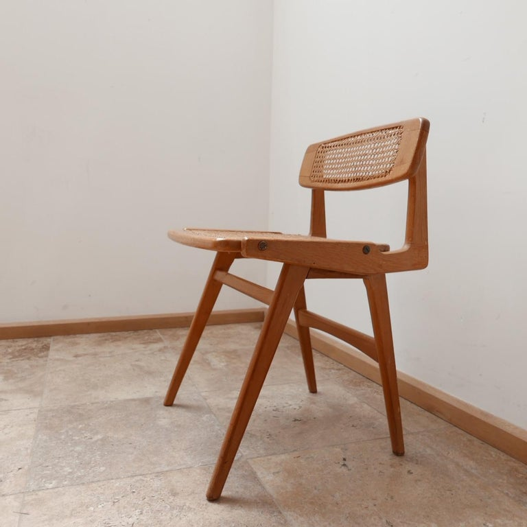 A scarce desk chair by Roger Landault.   France, c1950s.  Mahogany and cane.   Very stylish with amazing lines.   Good condition.   Dimensions: 48 W x 45 D x 45 seat height x 69 total height in cm.   Delivery: POA.