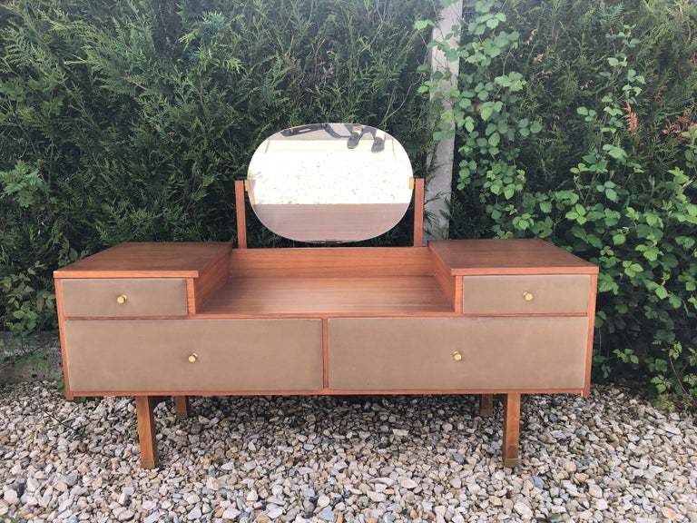 Beautiful vanity in teak with two drawers and two cases on top, brass legs and handles Design Roger Landault in the 1950s.