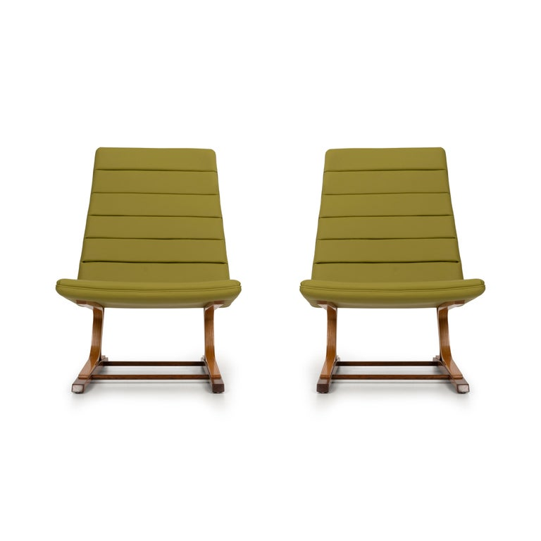 Roger Lee Sprunger for Dunbar pair of cantilever lounge chairs, model 480, oakwood base structures, oil finish, reupholstered with spinney beck leather.