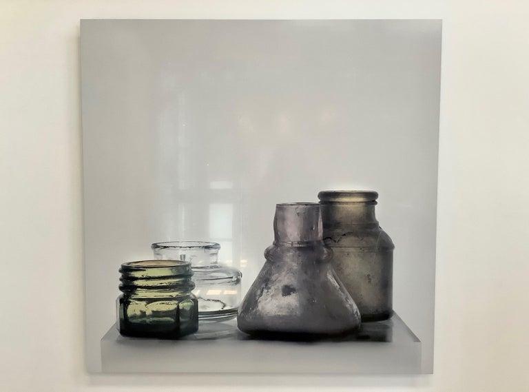 Small Bottles 17, Square Still Life Photograph of Glass Bottles on White For Sale 6