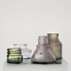 Small Bottles 17, Still Life Photograph of Pale Green, Gray and Brown Glass Jars