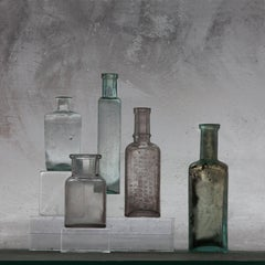 Small Bottles 22, Square Still Life Photograph of Glass Bottles on Gray