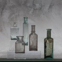 Small Bottles 22, Still Life Photograph of Glass Bottles on Gray