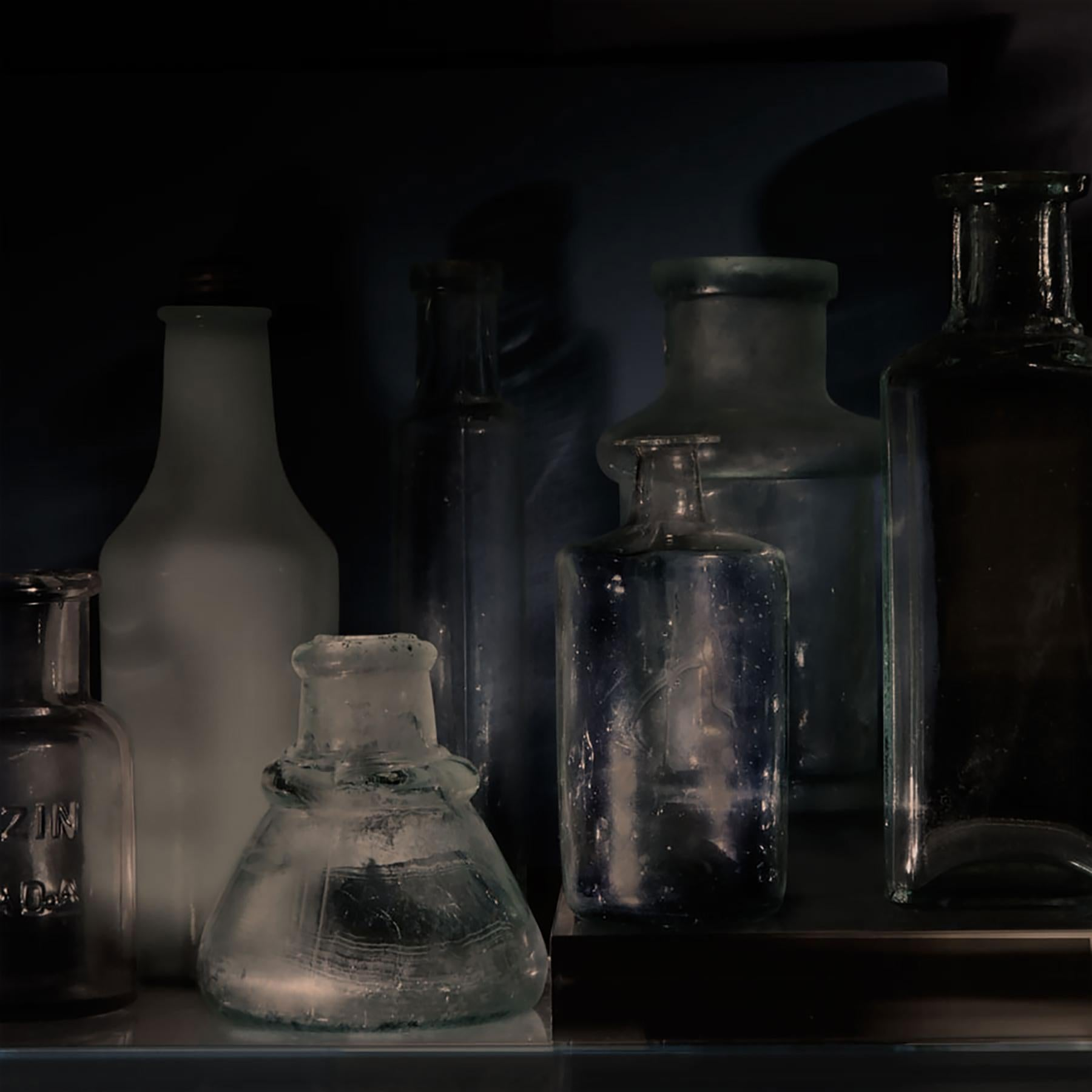 Small Bottles 24a, Still Life Photograph of Glass Bottles on Black Background