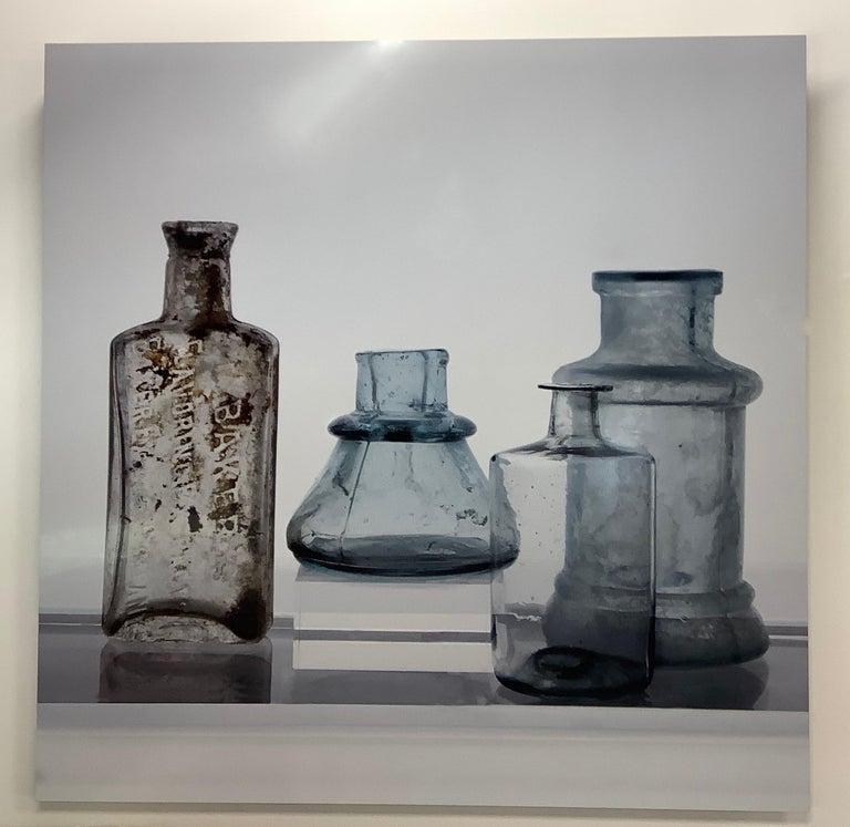 Small Bottles Nine, Square Still Life Photograph of Glass Bottles on White - Gray Still-Life Photograph by Roger Ricco