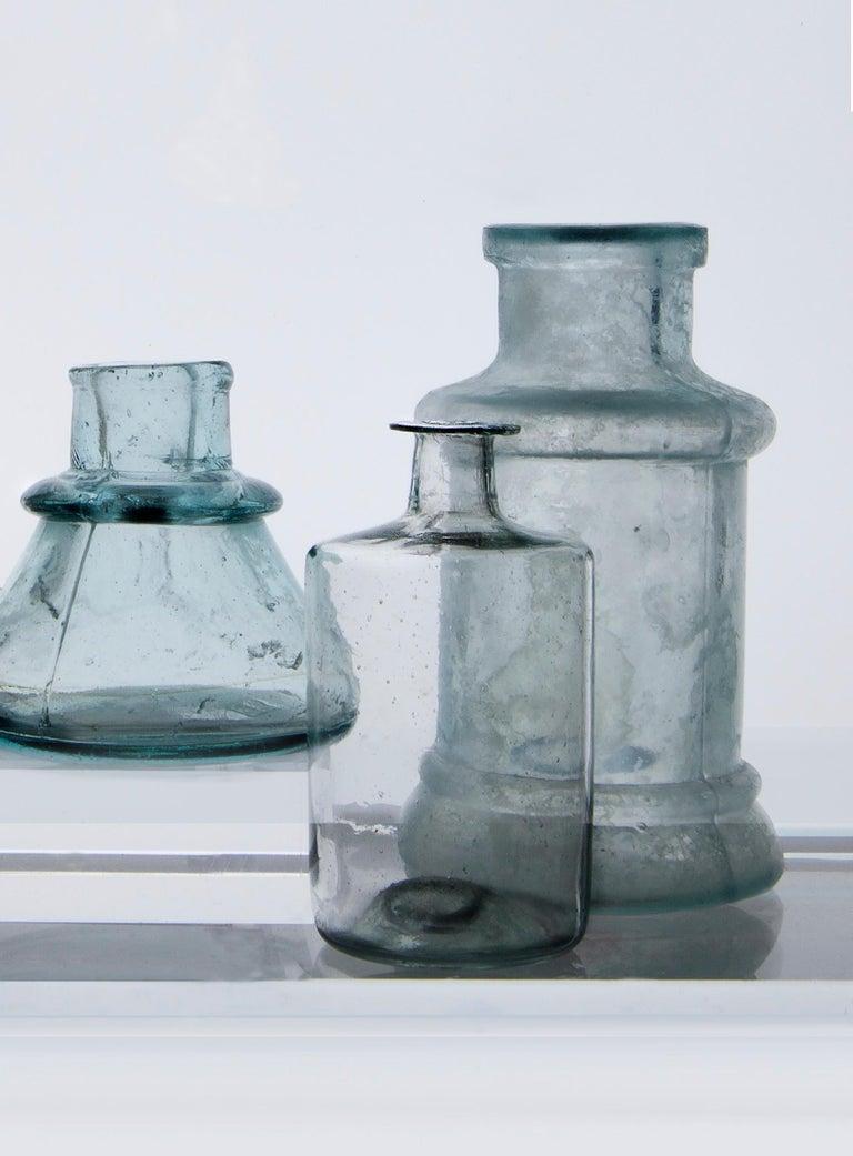 Small Bottles Nine, Square Still Life Photograph of Glass Bottles on White For Sale 1