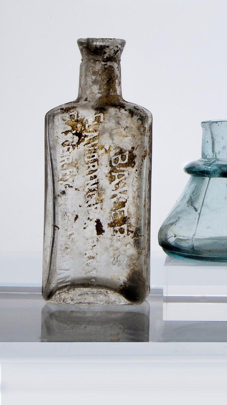 Small Bottles Nine, Square Still Life Photograph of Glass Bottles on White For Sale 2