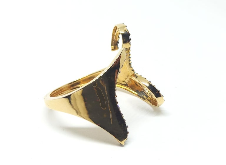 Rohit lets his mind wander to create work unlike his previous work, thereby creating One Of a Kind pieces only, a challenge he truly loves. This Contemporary Ring in 18 Karat Yellow Gold features Round white Diamonds with accents of Black rhodium in