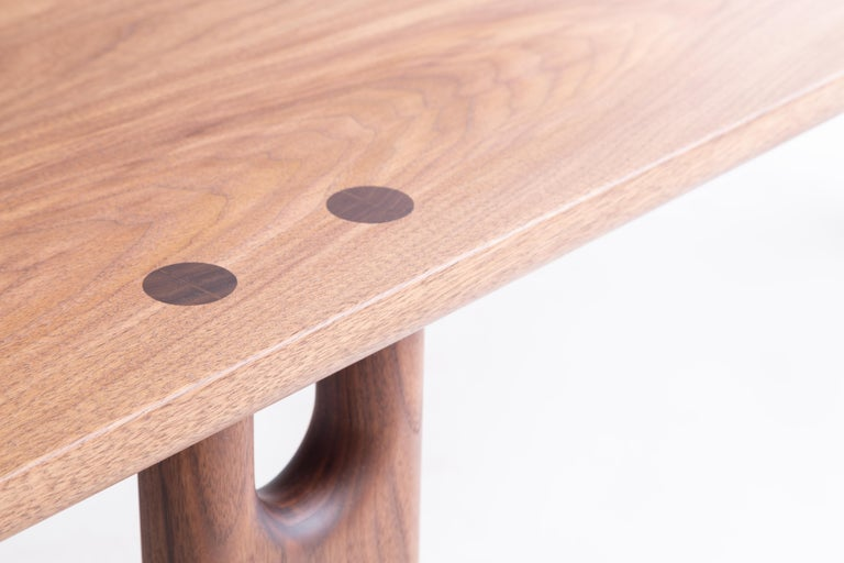 The Roland bench is built by hand in our Louisville, KY studio using premium solid hardwoods. Simple and sturdy, the bench highlights its unique double tenon joinery with the shaped legs. Sized for a standard dining bench, it also well suited as a