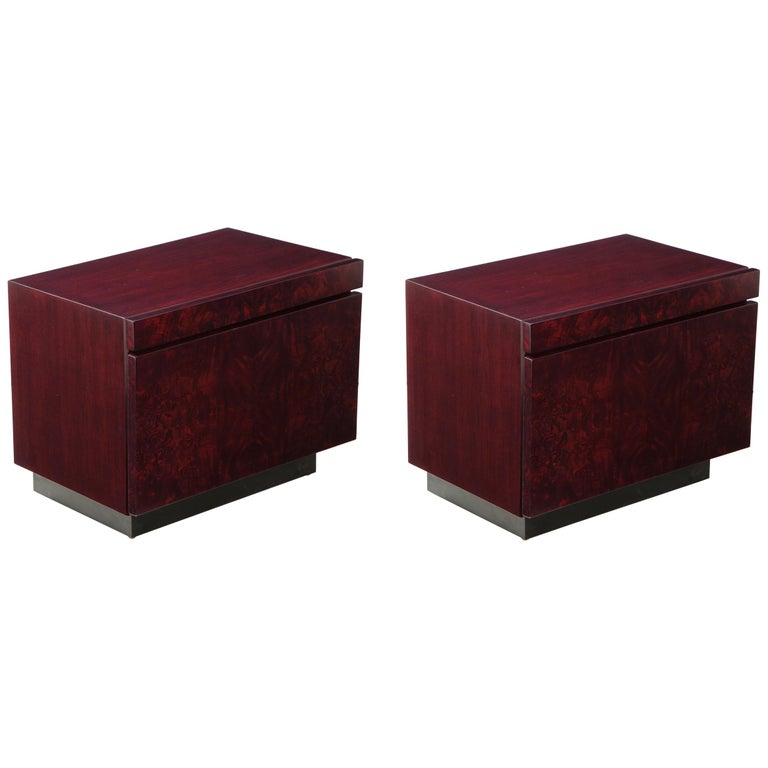 Pair of mint restored burl nightstands featuring a custom color red wine stain. Each featuring an ample sized bottom drawer and a laminate lined pullout / pull-out drinks tray all sitting on a matte black lacquer base. Roland Carter for Lane.