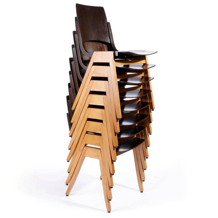 A set of eight stacking chairs designed by Professor Roland Rainer (1910-2004) in 1952 and manufactured by Emil & Alfred Pollak, Vienna. Roland Rainer used these chairs for the Viennese city hall