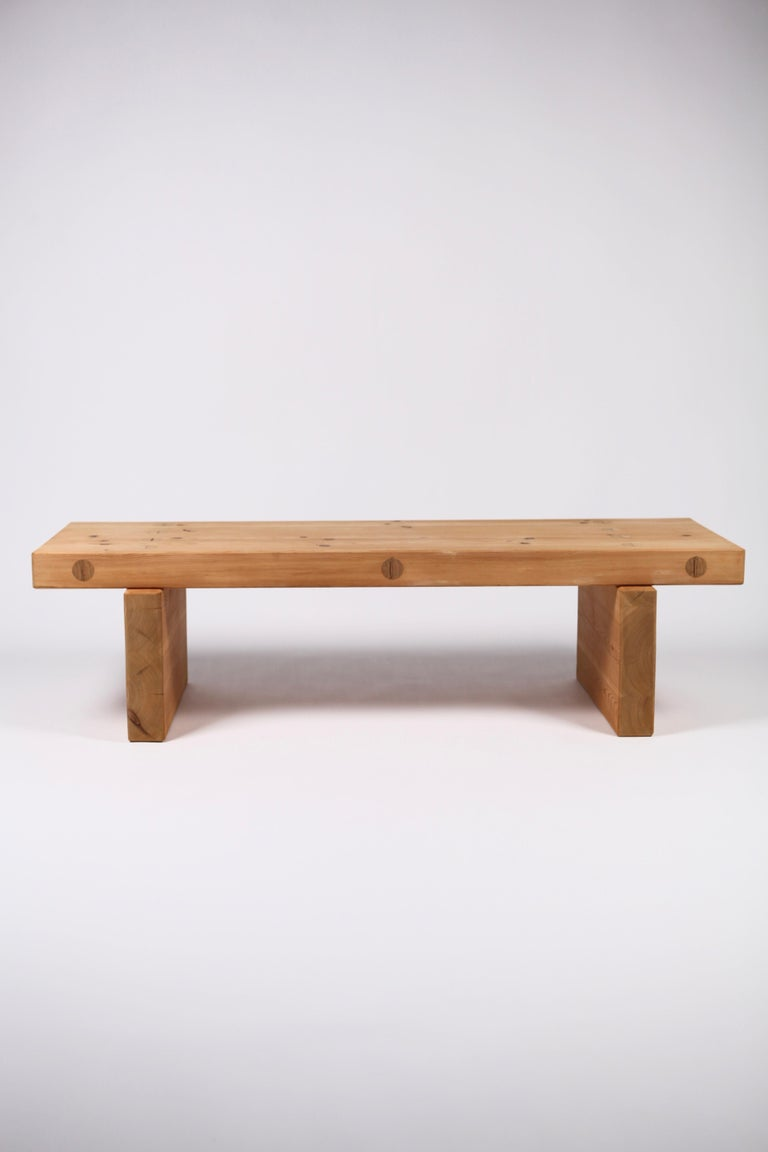 A timeless Scandinavian Modern bench or coffee table in solid thick pine by Roland Wilhelmsson, executed in Sweden, 1970. Characteristic visible wood joints and great craftsmanship. Signed to the underside.