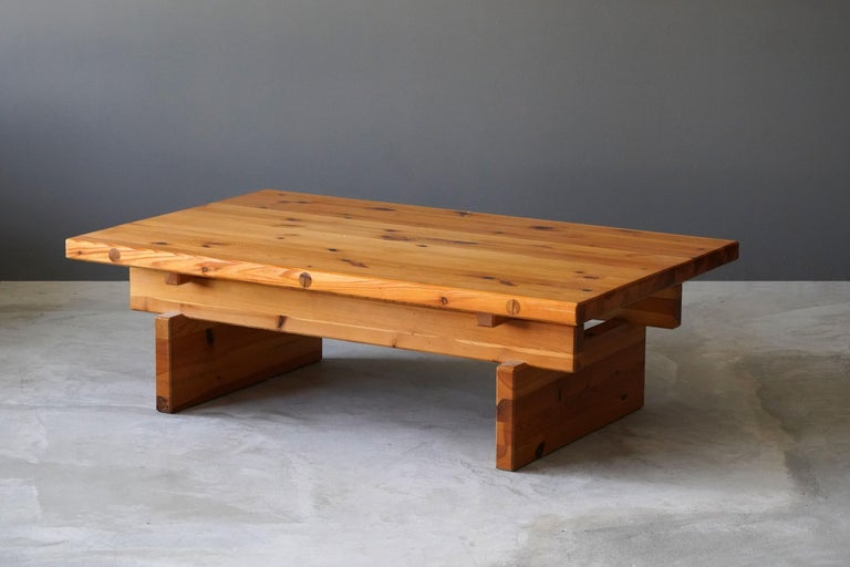A coffee table or bench, designed by Roland Wilhelmsson, produced by Timmermannen, Sweden, 1970s  This highly functionalist piece is produced using what Wilhelmsson referred to as the