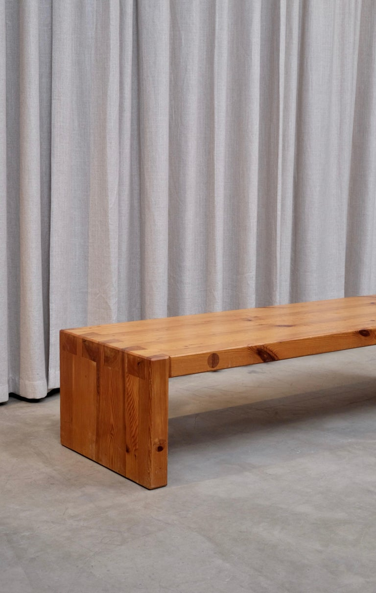 Rare model, handcrafted massive pine coffee table / bench. Designed by Roland Wilhelmsson and executed by the hand of the artist in Ågesta, Sweden. Hand-signed Roland Wilhelmsson, Ågesta. Artists emblem is carved on the underside.