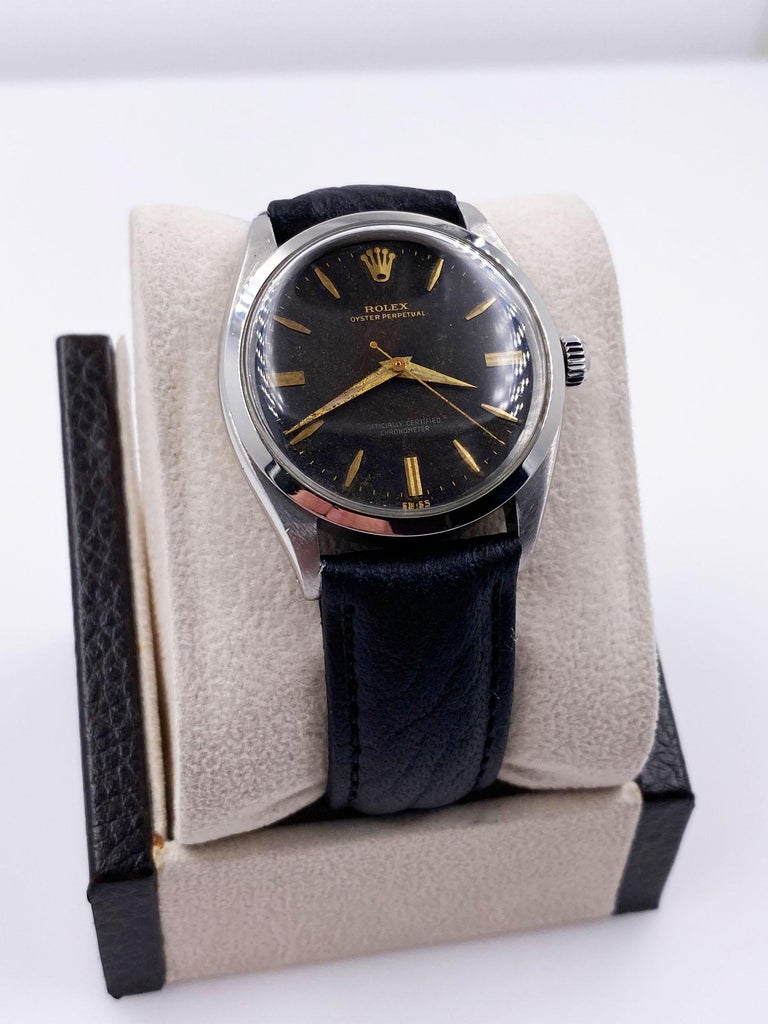 Style Number: 1007     Serial: 1693***   Year:1963     Model: Oyster Perpetual     Case Material: Stainless Steel     Band: Custom Leather Band     Bezel:  Stainless Steel     Dial: Black Dial      Face: Acrylic Crystal     Case Size: 34mm