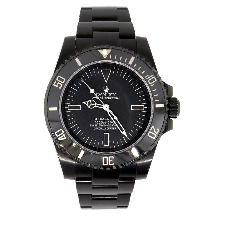 Brand: Rolex MPN: 114060 Model: Submariner No date Case Material: Stainless Steel DLC Coated Case Diameter: 40mm Crystal: Sapphire crystal Bezel: Black Ceramic bezel. Dial: Black dial with white stick and hands. No Date Bracelet: Stainless steel DLC