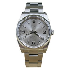 Rolex 114200 Oyster Perpetual Silver Dial Stainless Steel Box Papers