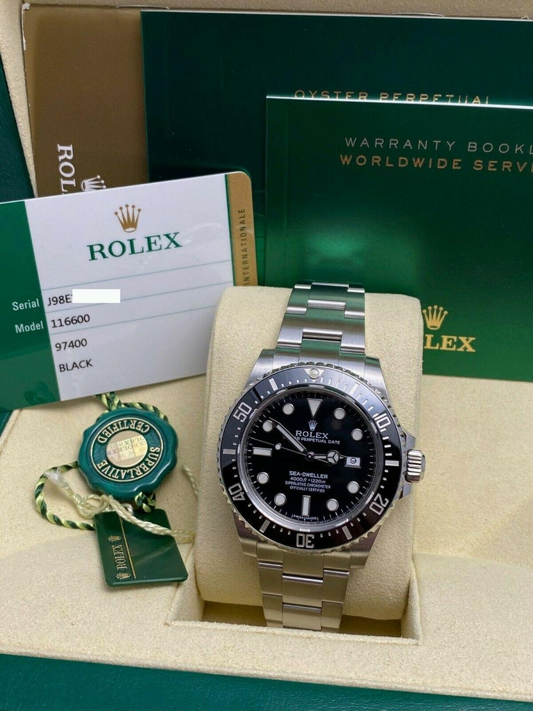 Style Number: 116600     Serial: J98E1***   Year: 2015     Model: Sea Dweller      Case Material: Stainless Steel     Band: Stainless Steel     Bezel: Black      Dial: Black     Face: Sapphire Crystal      Case Size: 40mm     Includes:   -Rolex Box