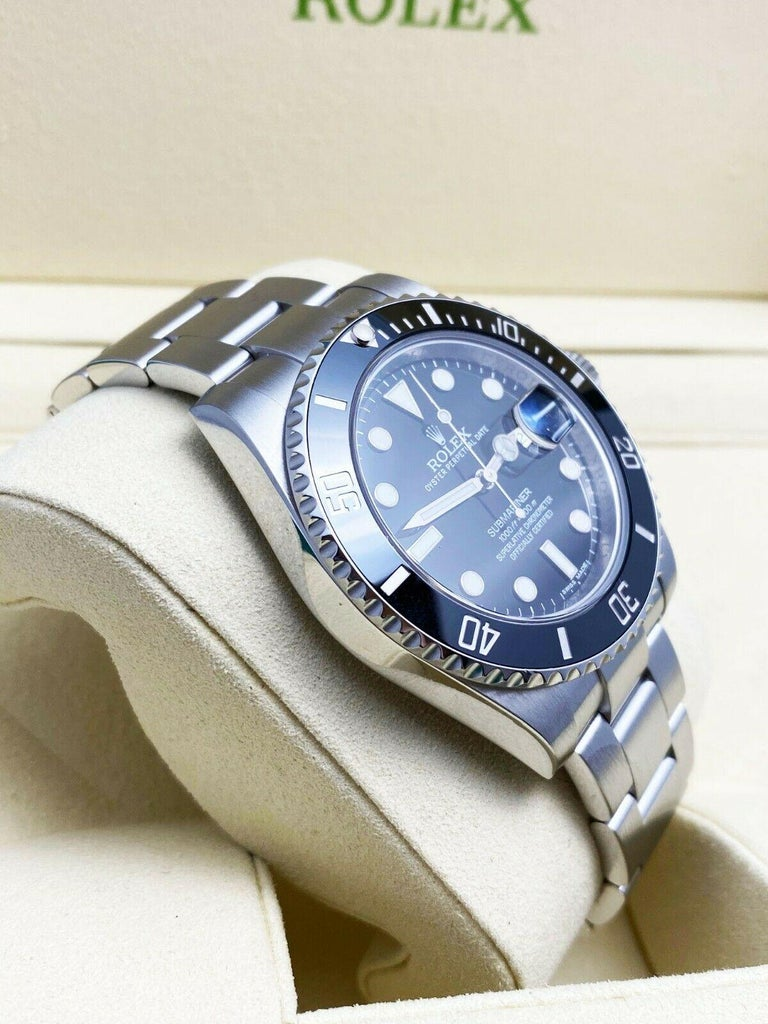 Style Number: 116610      Serial: 7116K***   Year: 2014     Model: Submariner     Case Material: Stainless Steel     Band:  Stainless Steel     Bezel:  Black Ceramic Bezel     Dial: Black     Face: Sapphire Crystal      Case Size: 40mm     Includes: