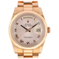 Rolex 118205 Day-Date Pink Roman Dial 18 Karat Rose Gold Women's Watch