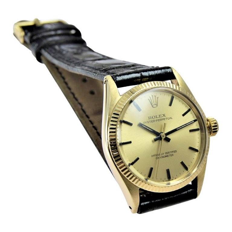FACTORY / HOUSE: Rolex Watch Company STYLE / REFERENCE: Oyster Perpetual / Ref. 6551 METAL / MATERIAL: 14Kt. Solid Gold CIRCA / YEAR: 1965 or 66 DIMENSIONS / SIZE: 33mm X 27mm MOVEMENT: Perpetual Winding / 26 Jewels / Cal. 1160 DIAL / HANDS: