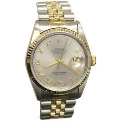 Rolex 16233 Datejust Silver Roman Dial 18 Karat Yellow Gold and Steel