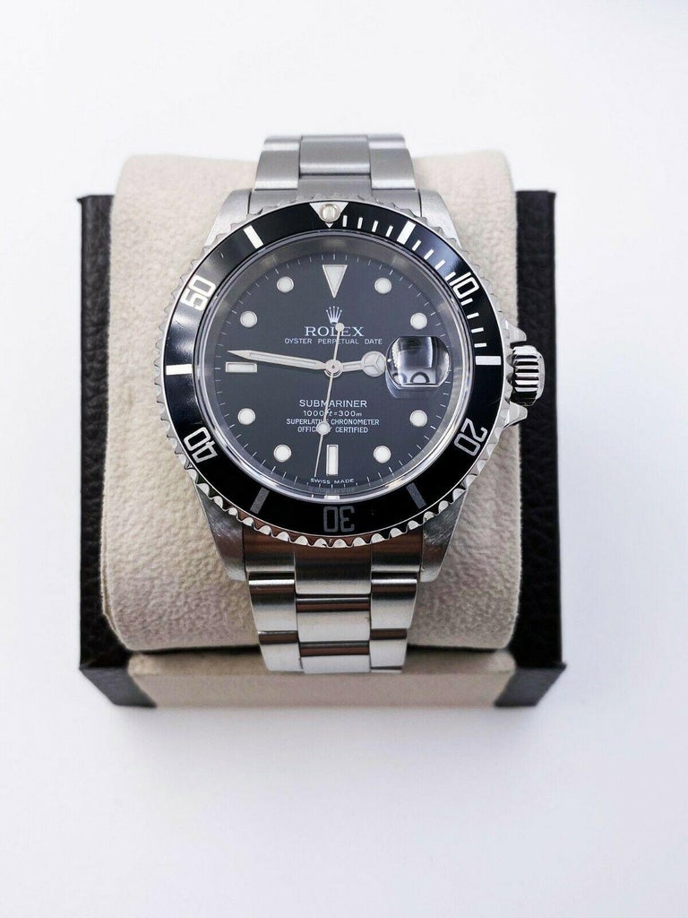Style Number: 16610     Serial: F567***   Year: 2005     Model: Submariner      Case Material: Stainless Steel     Band: Stainless Steel     Bezel: Black     Dial: Black      Face: Sapphire Crystal      Case Size: 40mm     Includes:   -Elegant Watch