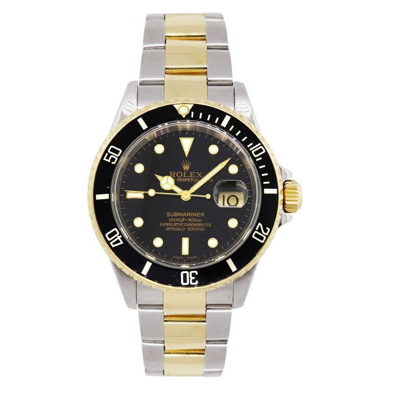 Brand: Rolex MPN: 16613 Model: Submariner Case Material: Stainless steel Case Diameter: 40mm Crystal: Sapphire crystal Bezel: Unidirectional black bezel Dial: Black dial Bracelet: Stainless steel and 18k yellow gold oyster band Size: Will fit up to
