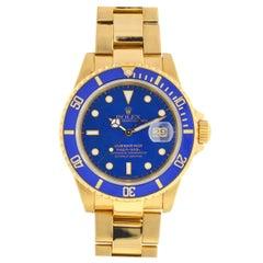Rolex 16808 Submariner 18 Karat Yellow Gold Blue Dial Automatic Men's Watch