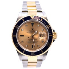 Rolex 18 Karat Gold and Stainless Steel Rolex Submariner with Serti Dial Watch