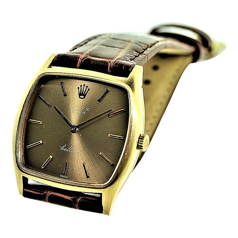 FACTORY / HOUSE: Rolex Watch Company STYLE / REFERENCE: Cushion Shaped Cellini METAL / MATERIAL:  18kt Yellow Gold CIRCA: 1980's DIMENSIONS: 35mm X 31mm MOVEMENT / CALIBER: 19 Jewels / 1600 Caliber DIAL / HANDS: Champagne with Baton Markers / Baton