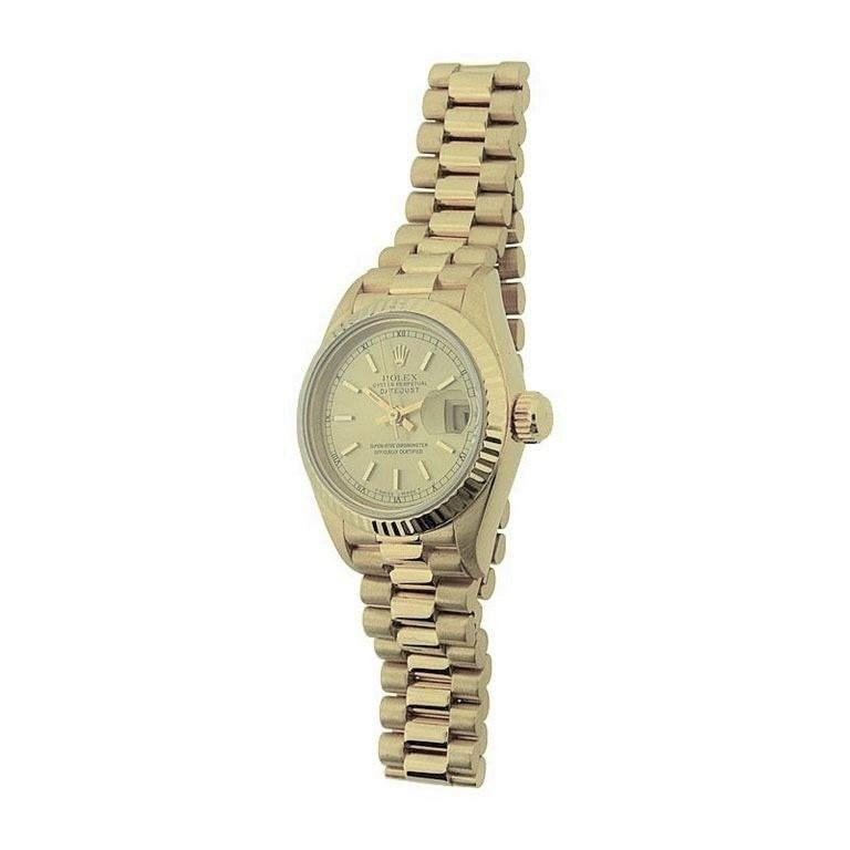 FACTORY / HOUSE: Rolex / Lady President STYLE / REFERENCE: President / President Bracelet METAL / MATERIAL: 18kt CIRCA: 1990's DIMENSIONS: 32 X 29 MOVEMENT / CALIBER: 29 Jewels DIAL / HANDS: Original Champagne with Baton Markers / Baton