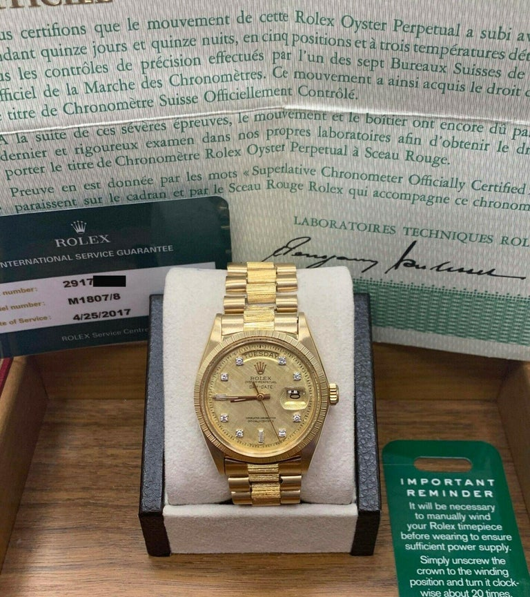 Style Number: 1807 Serial: 2917*** Model: President Day Date Case Material: 18K Yellow Gold Band: 18K Yellow Gold Bezel: 18K Yellow Gold Dial: Original Factory Diamond Dial Face: Acrylic  Case Size: 36mm Includes:  -Rolex Box & Papers and Service