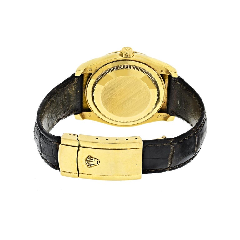 Rolex 116138 Oyster Perpetual Datejust, 116138, 18k Yellow Gold Case on a Strap with an 18k Yellow Gold Deployant Buckle, Automatic Movement, Date, White Dial with Roman Numerals.   The strap needs to be replaced it shows wear.   The watch will be