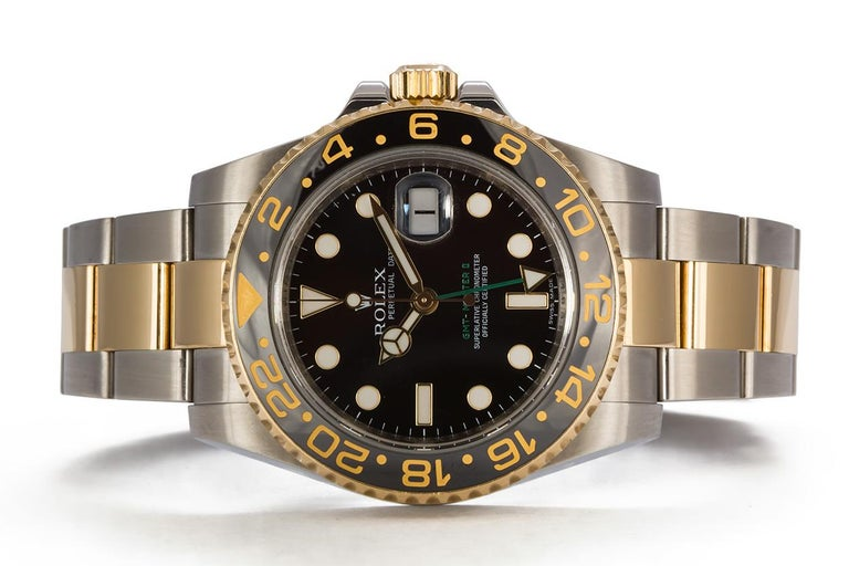We are pleased to offer this 2008 Rolex GMT Master II 18k Gold & Stainless Steel 116710. It features a 40mm stainless steel case with black dial, 18k yellow gold bezel with black ceramic GMT insert, engraved inner bezel, stainless steel and 18k
