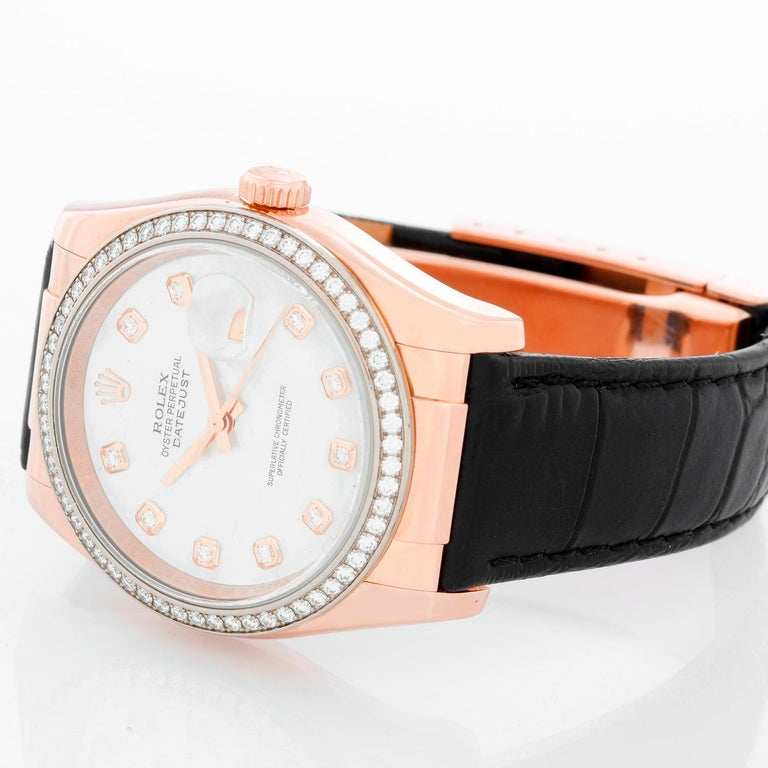 Rolex Rose Gold Datejust Mother of Pearl Watch 116185 - Automatic winding, 31 jewels, sapphire crystal. 18k rose gold case with 60-diamond bezel. Factory mother of pearl diamond dial. Leather strap band with 18k rose gold deployant clasp. Pre-owned
