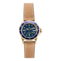 Rolex 18 Karat Gold Oyster Perpetual Submariner with Blue Gloss Earth Dial