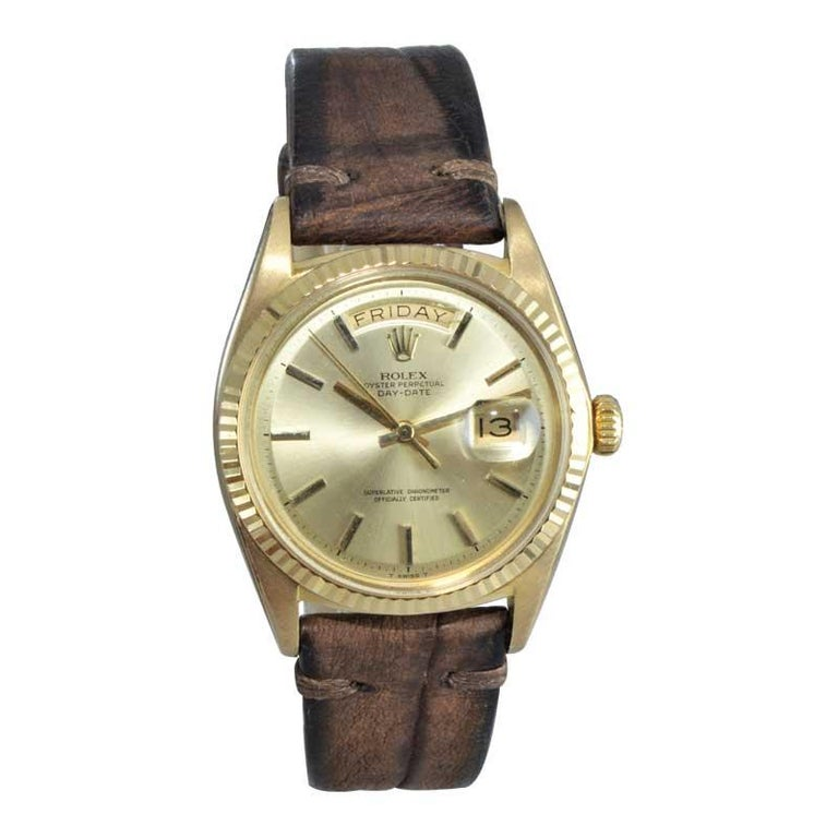 FACTORY / HOUSE: Rolex Watch Co. STYLE / REFERENCE: Day Date / Ref 1803 METAL / MATERIAL: 18Kt CIRCA / YEAR: 1969 DIMENSIONS / SIZE: 44mm x 36mm  MOVEMENT / CALIBER: Oyster Perpetual Winding / 26 Jewels  DIAL / HANDS: Original Brushed Gold / Gold