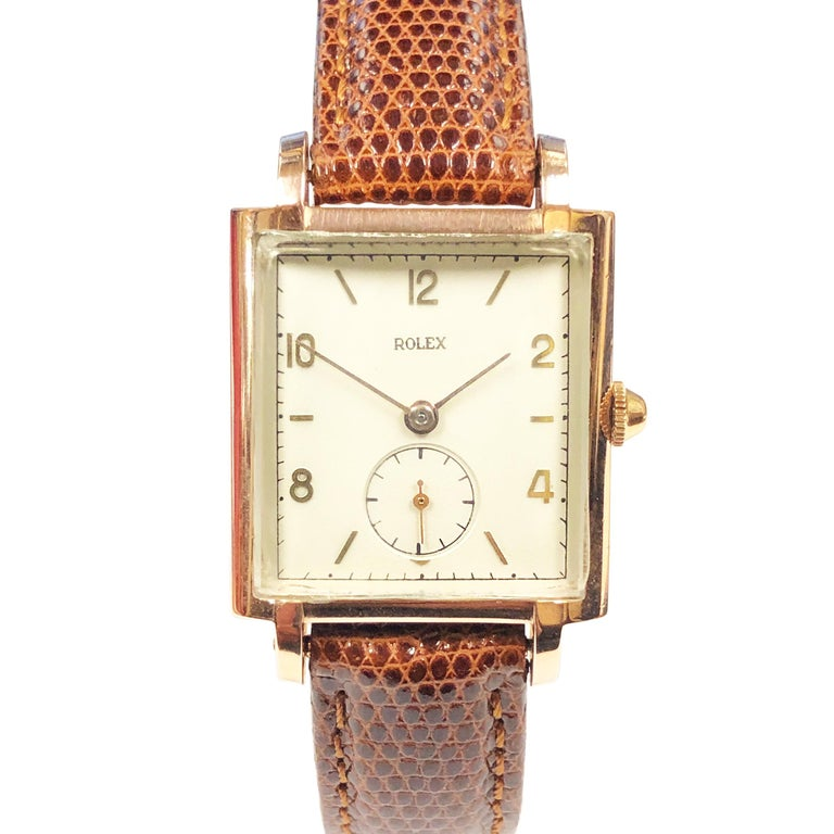 Circa 1940 Rolex Wrist Watch, 39 X 27 MM 2 piece case with a Rose Gold Shell Top and a Stainless Steel Back. 17 Jewel Mechanical, Manual wind Movement, original and mint condition Silver - White Dial with Raised Gold Markers. New L.W. Swiss Brown