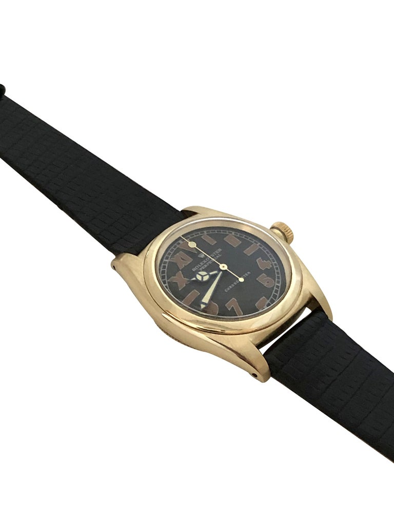 Circa 1948 Rolex Bubble Back Wrist Watch, 32 M.M. 3 Piece 14K Yellow Gold case with smooth Bezel, Automatic, Self Winding movement. Restored  Black Dial with Radium style filled Half Roman and Half Arabic numerals, restored Mercedes Hands with sweep