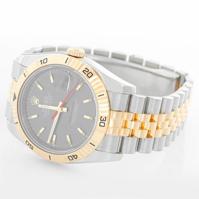 Rolex 2-Tone Turnograph Men's Steel & Gold Watch Slate Dial 116263 - Automatic winding with date; sapphire crystal; 31 jewels. Stainless steel case with 18k yellow gold rotating Thunderbird bezel  (36mm diameter). Slate gray dial with gold stick
